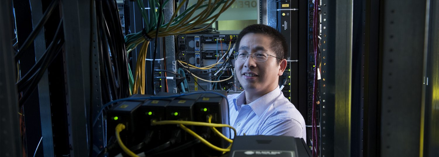 Xuxian Jiang inside of the OSCAR labs on Centennial Campus. He teaches computer science. Photo by Marc Hall