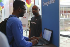 An attendee learns about Google Fiber in the Triangle