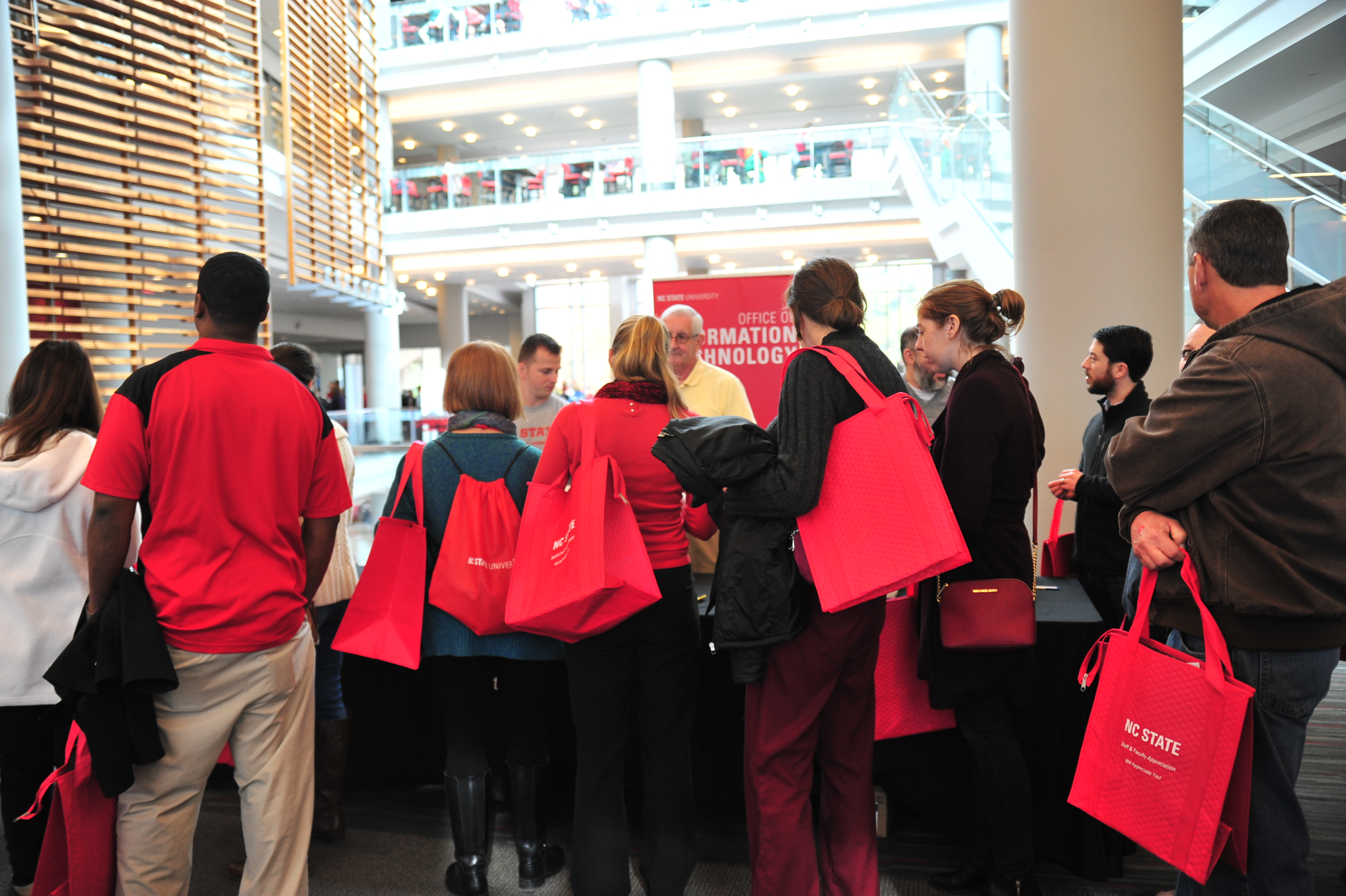 A crowd gathers around the OIT table.