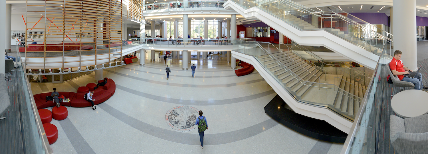 A student walks through the entryway of Talley Student Union.