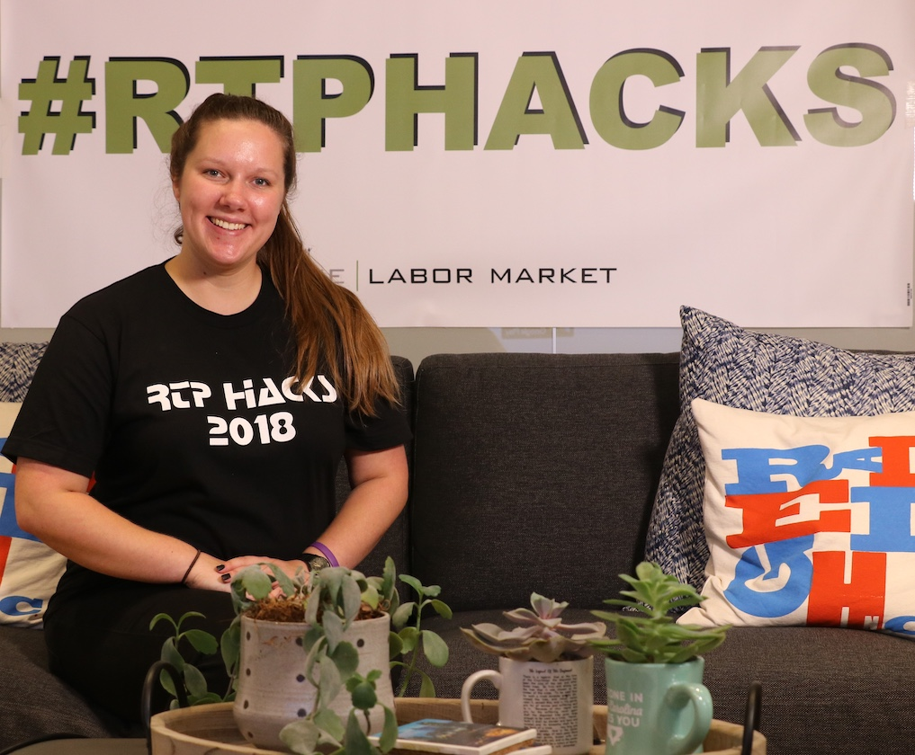 Mia Freeland and Stevie Thompson (not shown) of OIT's PML internship program participated in the RTP Hacks 2018: Southeast Raleigh hackathon, which showcased the high-tech workforce of the future. Photo by Stevie Thompson.